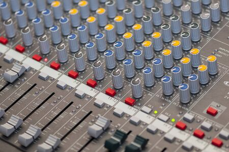 audio mixer: Close-up on knobs of an audio console. Digital audio board. Studio workstation. Mixing console.
