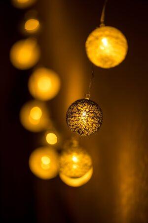 Decorative globe, light bulbs on the wall. Hanging lights. Selective focus