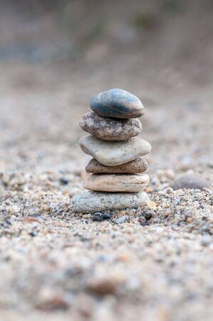 Small balancing stones sitting on other rocks Stok Fotoğraf