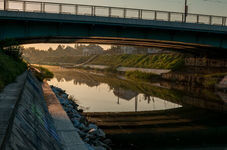 A view of the Bega river early in the morning. Sunrise in the city. Mihai Viteazul bridge.