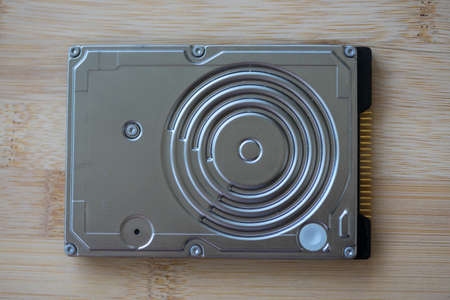 Top view of a hard disk drive on a wooden table