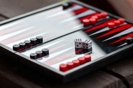 Close-up of a backgammon table. Focus on the dice.