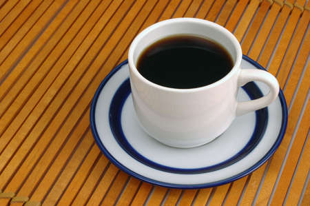placemat: Coffee cup and saucer on wood slat place-mat