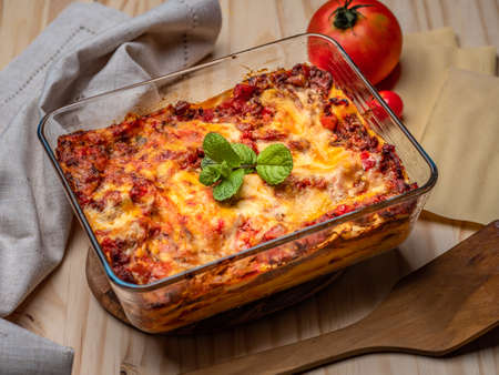 Lasagna ready to serve on wood table