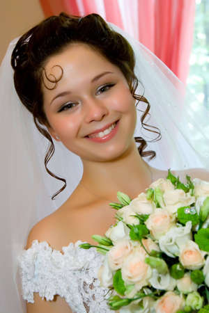 beautiful young bride with wedding bouquet of roses Stock Photo - 4978414