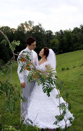 young newlyweds couple outdoors photo