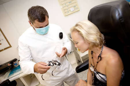 doctor of optometry: Doctor,examining a patient in ophthalmology clinic