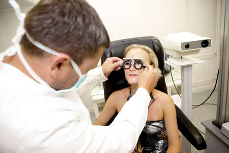 diopter: Doctor,examining a patient in ophthalmology clinic