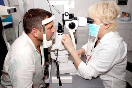doctor of optometry: Examining  in ophthalmology clinic Stock Photo