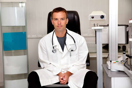 Young doctor man with stethoscope  photo