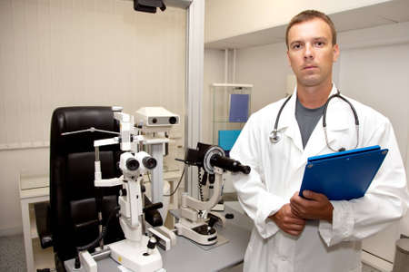 Young doctor man with stethoscope and clipboard  photo