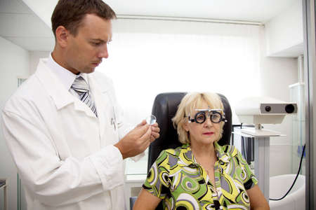 Doctor,examining a patient in ophthalmology clinic photo