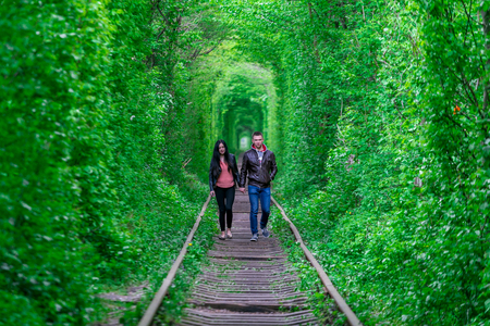 The guy with the girl gudlyayut railroad tunnel of love spring forest Editorial