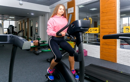 GRODNO, BELARUS - OCTOBER 24, 2017.Beautiful girl is engaged in a gym