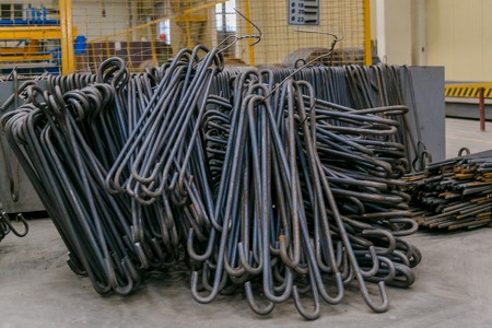 Rolls of aluminum metal fittings steel armature . Heavy industry production. Metal rolling plant Standard-Bild