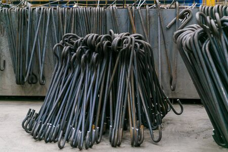 Rolls of aluminum metal fittings steel armature . Heavy industry production. Metal rolling plant Stock Photo