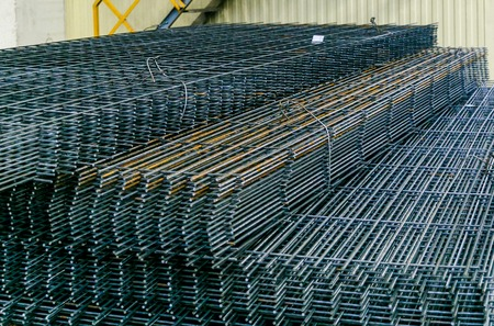 Rolls of aluminum metal fittings steel armature . Heavy industry production. Metal rolling plant Stok Fotoğraf