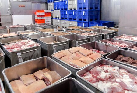 cutting beef at a meat factory.