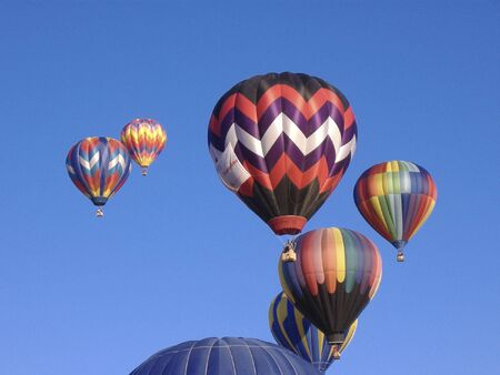Several Colorful Hot Air Balloons against blue sky