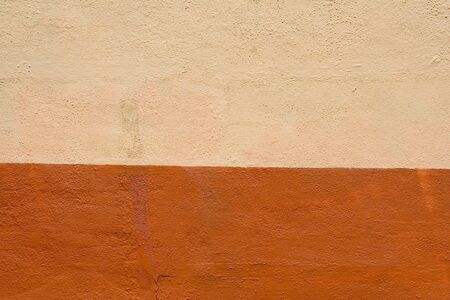 Closeup abstract of orange and beige stucco wall, great copy space or background