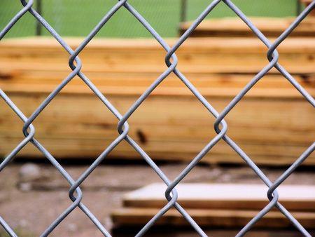 Chain Link Fence Protecting Lumberyard photo