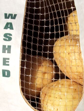 Organic Potatoes In Recycled Paper Bag photo