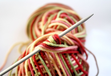 Wool of various colours with knitting needle photo
