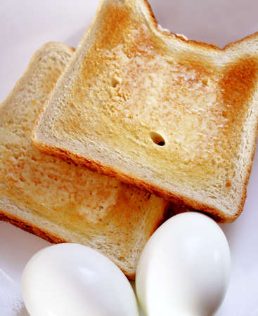 hard boiled: Two hard boiled eggs with buttered toast