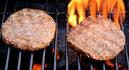 Tasty Hamburgers On An Outdoor BBQ