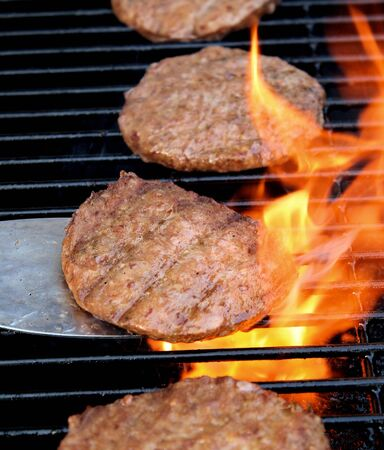 blazing: Flame Broiled Hamburgers On An Outdoor BBQ