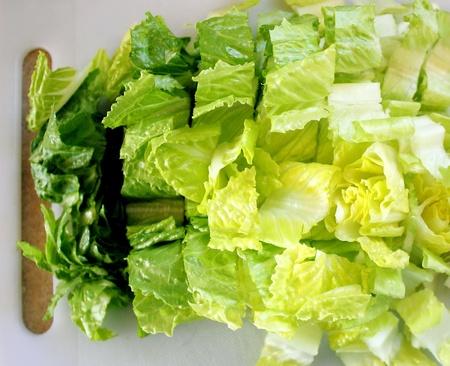 Chopped Romaine Lettuce On Cutting Board photo