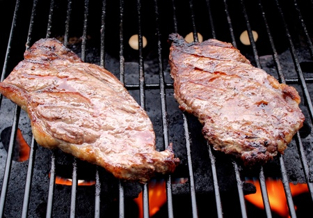sizzling: Sizzling Steaks On The BBQ