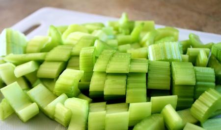 celery: Chopped Celery On Cutting Board