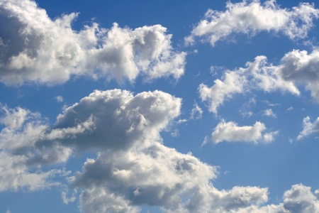 blue sky: White fluffy clouds in a bright blue sky