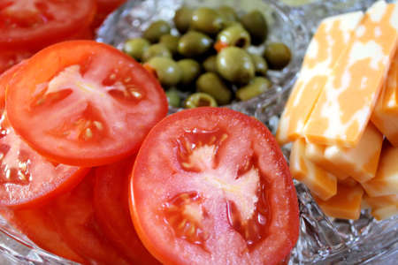 Tomato slices, cheese and green olives - garnish tray Stock Photo - 9779527