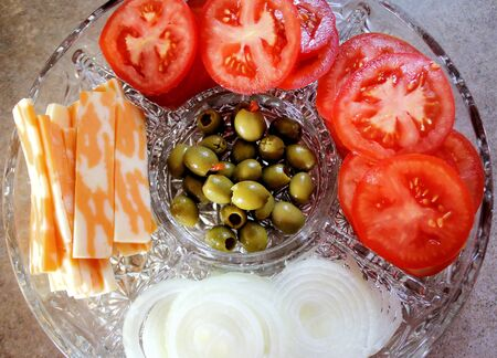 Tomatoes, olives, cheese and onions - appetizer tray Stock Photo - 9779530