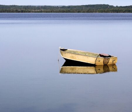 A fishing boat on the calm waters of a beautiful lake