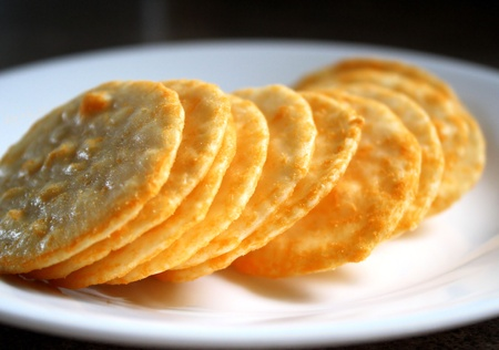 crackers: Cheese Flavoured Rice Crackers Stock Photo