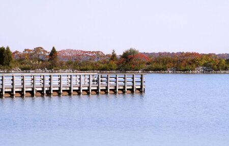 changing seasons: Walking Pier On Beautiful Lake