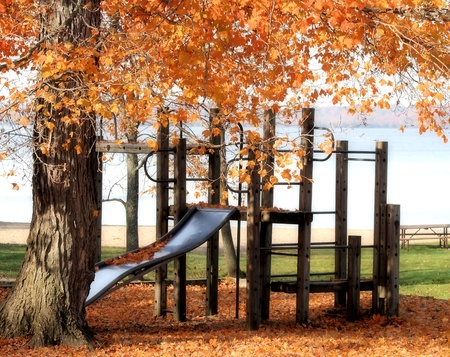 Playground at outdoor park - lake in the background