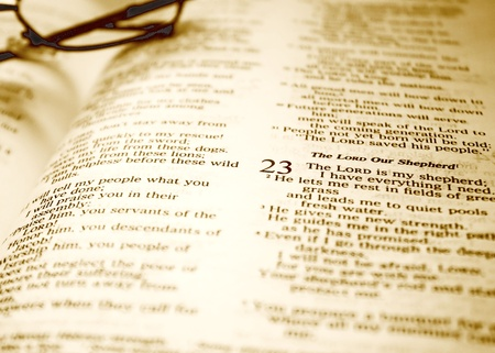 psalm: The Family Bible - opened at Psalm 23, reading glasses in background