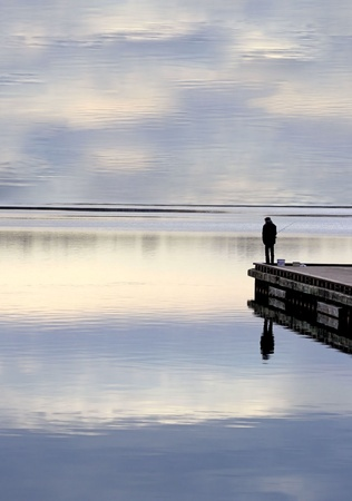 waters: Man Standing Alone Fishing Off Dock