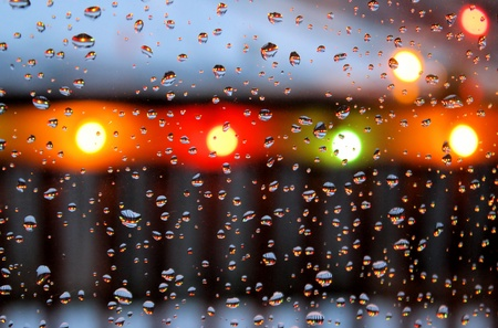 Lights Through The Window - raindrops on glass photo