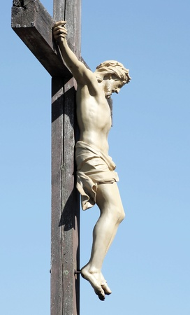 crucified: The Crucifixtion - Statue of Christ Nailed To A Wooden Cross