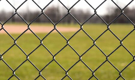 fence: Chain Link Fence Surrounding Baseball Field Stock Photo