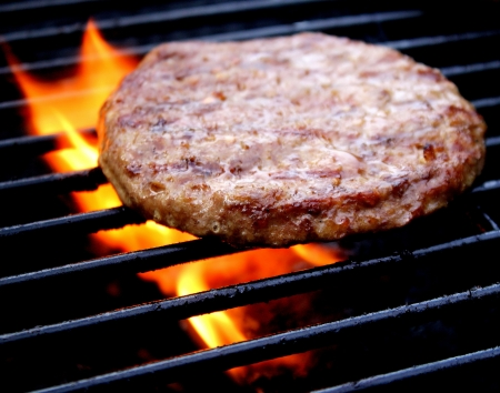 Juicy Burger Cooking On The Grill photo