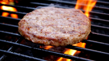 Beef Burger Cooking On The Grill Stock Photo