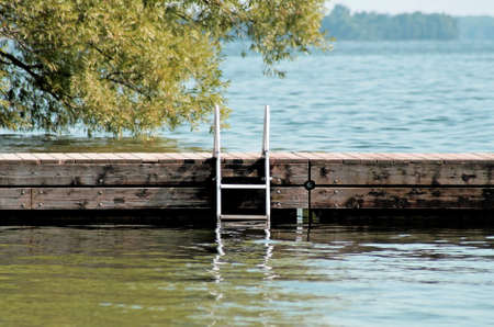 Swimming Dock With Ladder At Beautiful Lake photo