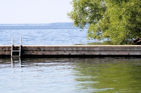 wooden dock: Swimming Dock At Beautiful Lake