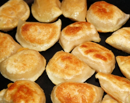Crisp Golden Perogies - stuffed with cheese and potato, fried in oil Stock Photo
